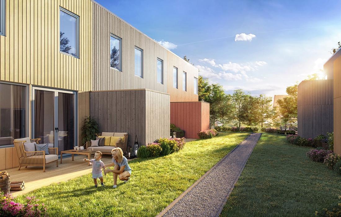Fasader mikrorekkehus, med gangsti mellom de to husrekkene.